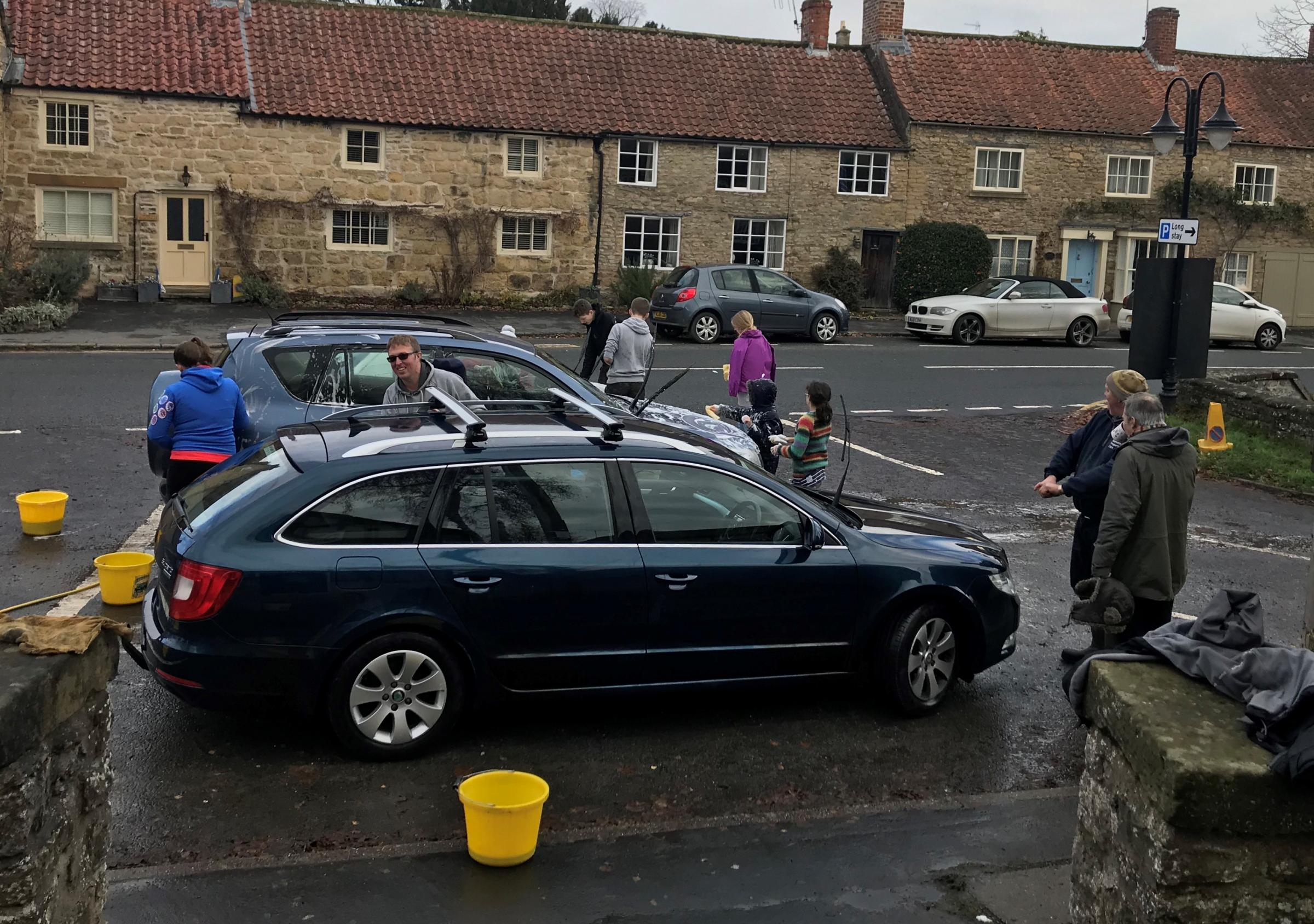 The 1st Helmsley Scout and Girlguiding Group who got together to wash cars and serve breakfasts to raise money for the scout hut rebuild