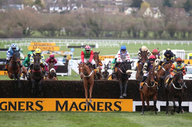 The Brian Ellison-trained Definitly Red, pictured centre in the Magners Cheltenham Gold Cup Chase earlier this year, has the Randox Health Grand National as his objective this season rather than the Cheltenham Gold Cup. Picture: Nigel French/PA Wire