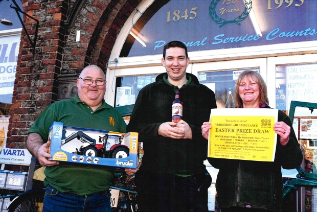 Andrew Monks, Shaun McIlravey and Terese Walker with some of the prizes on offer at this Friday's bingo evening in Old Malton