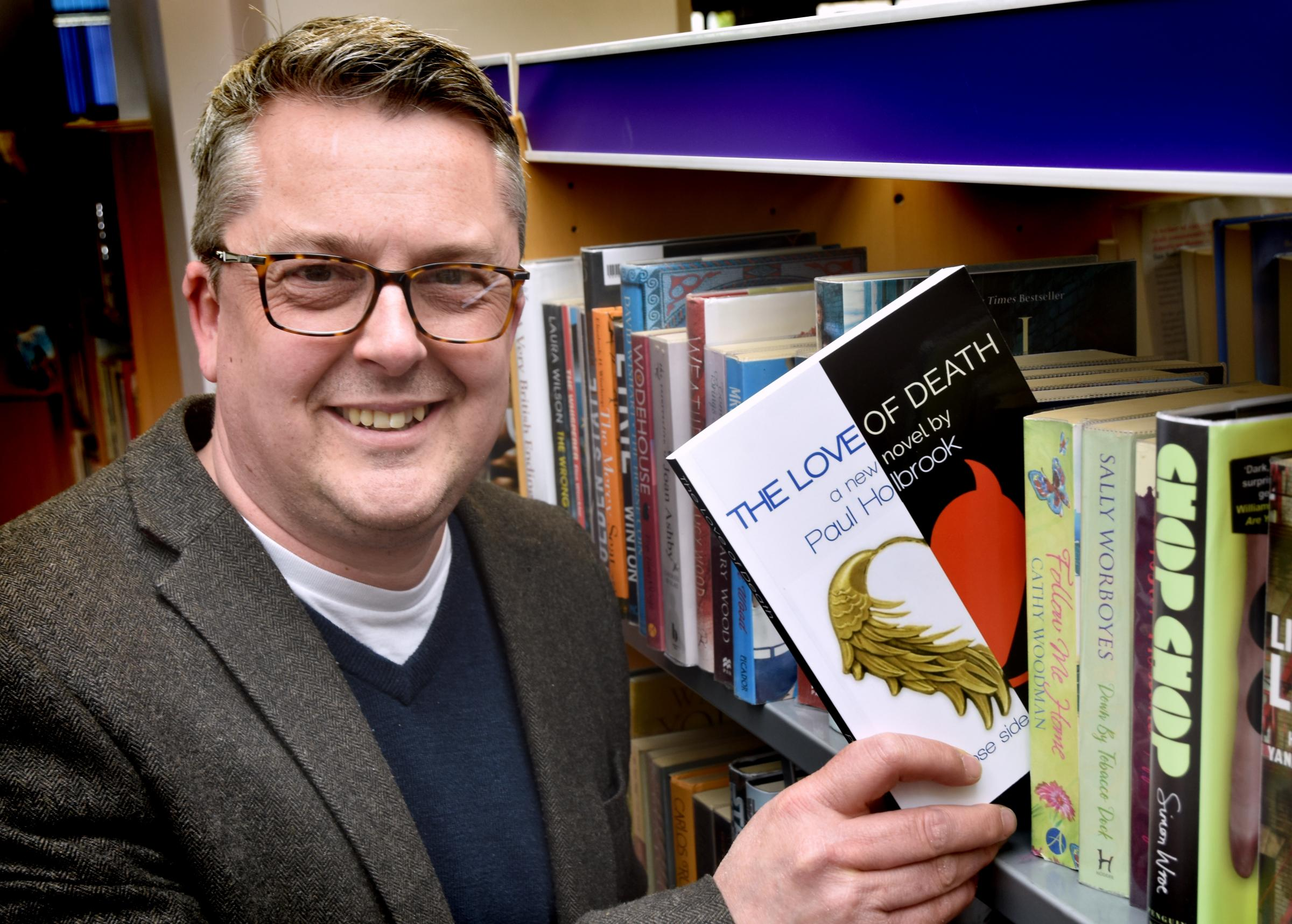 Author Paul Holbrook with his book new book The Love of Death, which has just been published      Picture: Frank Dwyer