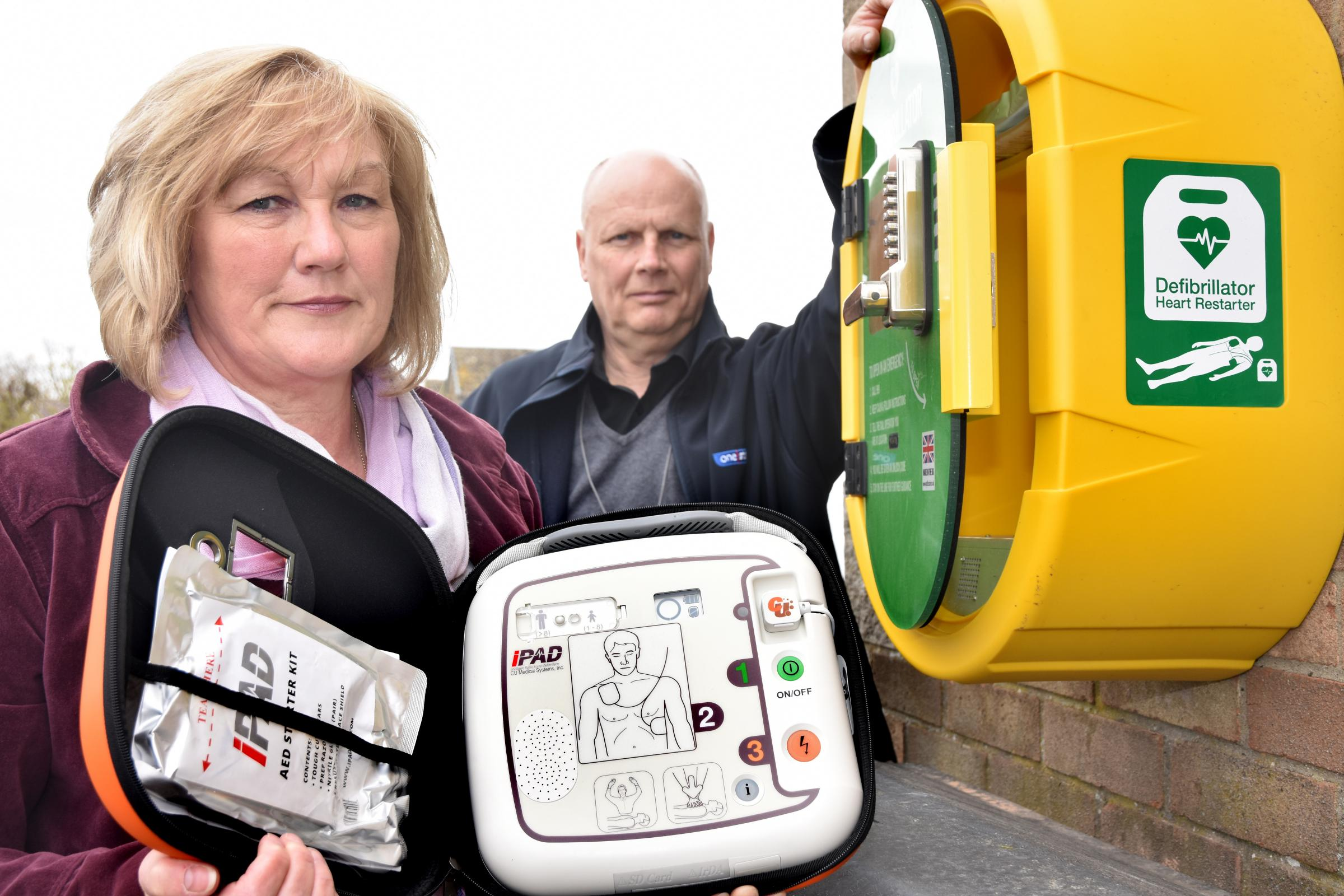 Sue Parsons and Yannis Henderson, store manager at the One Stop shop in Norton, with the new defibrillator   Picture: Frank Dwyer