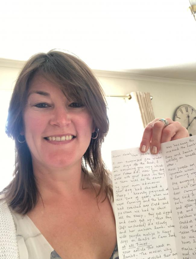 Sarah Walker with the letter she received about sheep-worrying