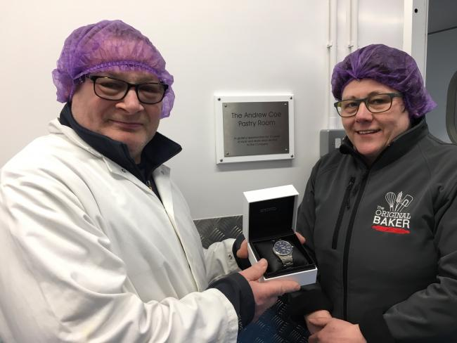 Gill Ridgard, managing director of The Original Baker, presenting Andrew Coe with an engraved watch and unveiling a surprise commemorative plaque on the wall of his workstation