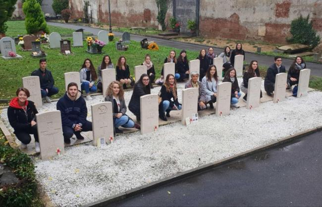 Italian teacher and students at the graves of the Turin Men on Remembrance Sunday last year                    Picture: Emma Pace