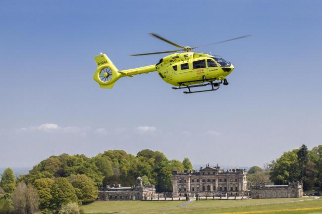 The Yorkshire Air Ambulance over Duncombe Park, where fundraisers raised £400,000 for six good causes, including the air ambulance