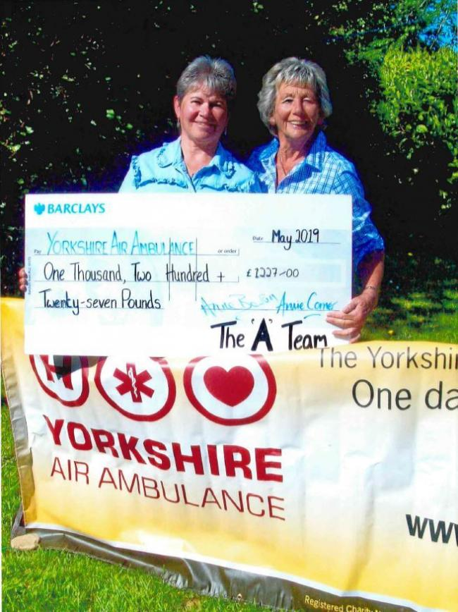 Angela Wiggle and Anne Baron with the cheque for Yorkshire Air Ambulance